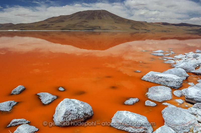 Laguna Colorada in Bolivia, the orange color is produced by a micro algae