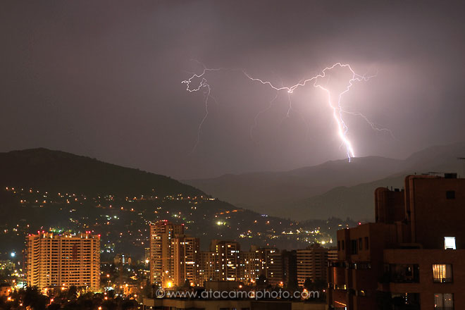 Electrical thunderstorm and lightning over the city of Santiago de Chile at night
