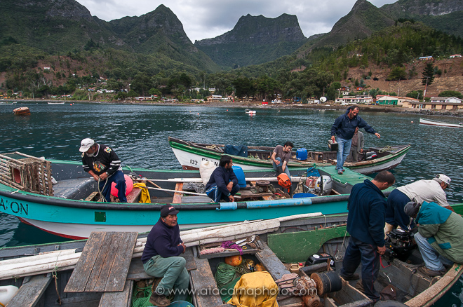 Fishermen with their boats at San Juan Bautista, Robinson Crusoe Island, Chile