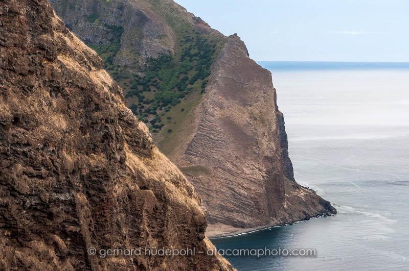Steep coastal cliffs of Robinson Crusoe Island, seen from Salsipuedes trail
