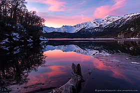 Lake Conguillio and Sierra Nevada, reflections at sunset in Conguillio National Park