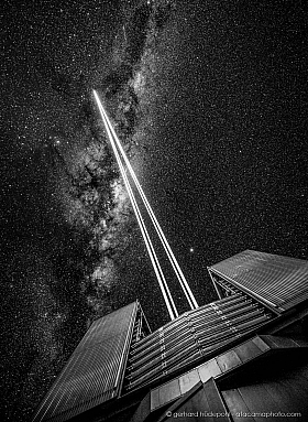 Black and White: The four lasers of Paranal Observatory are shooting to the stars of the Milky Way