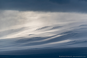 Fog, snow, clouds and mountains. McMurdo sound landscape like a painting