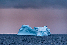 Blue iceberg with purple sky, Antarctic colors