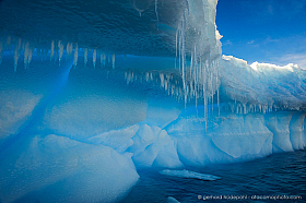 Detail of melting iceberg with icicles, Antarctica