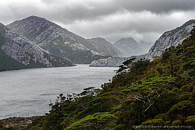 Limestone mountains and fjords, dramatic weather in a fjord of Isla Madre de Dios in Patagonia