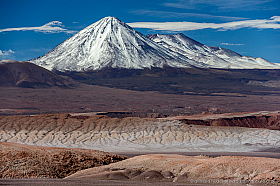 Volcanoes Licancabur and Juriques covered in snow