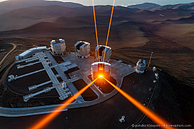 Unusual aerial drone view of the Very Large Telescopes with the 4 Laser Guide Stars shooting at the stars, Cerro Paranal Chile