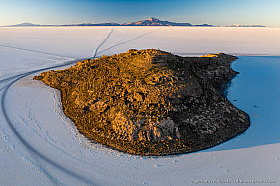 Aerial sunset view of Isla Incahuasi with Tunupa volcano, Salar de Uyuni