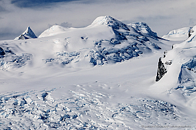 Wild mountains covered with thick ice and snow at Cierva Cove, Antarctica