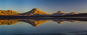 Four volcanoes are reflecting in Laguna Lejia, Lascar, Pili and Aguas Calientes