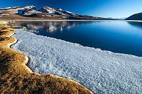 Frozen Laguna Santa Rosa, Nevado Tres Cruces national park in the Altiplano of Chile
