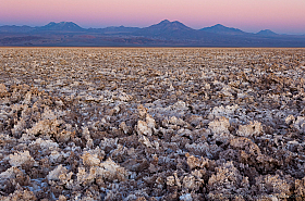 Salar de Atacama in evening light with volcanoes at the horizon
