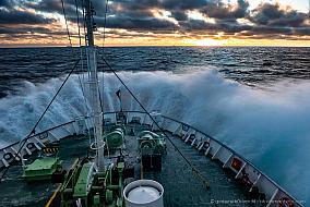 Sunrise while sailing the Antarctic ocean on board of Ortelius