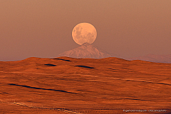 Full moon rising above Llullaillaco volcano