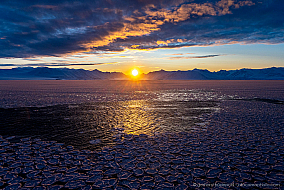 Antarctic ocean covered with pancake ice at sunset, McMurdo Sound, Antarctica