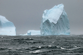 Dramatic iceberg scenery in the fog of the Scotia Sea on the way to Antarctica
