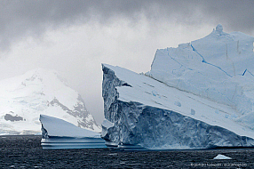 Iceberg landscape with dramatic weather in Paradise harbour, Antarctica