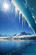 Melting iceberg with icicles in Antarctica near Port Lockroy