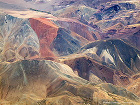 Rich mineral deposits produce the amazing colors of the Atacama desert mountains, Copiapo. Aerial photo.