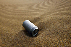 An empty can has been sandblasted by wind and sand of the Atacama desert