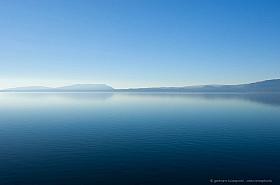 Morning haze at Villarrica Lake, blue water, blue sky
