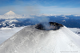 Aerial view: Tourists are climbing to the edge of active Villarica volcano crater in the south of Chile