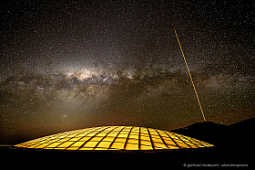 Light dome of Paranal Residencia with Milkyway and laser