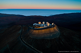 The first rays of the rising sun are illuminating the Paranal Observatory in the Atacama desert