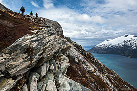Hikers enjoying the view from a mountain at Garibaldi Fjord, Beagle Channel Chile