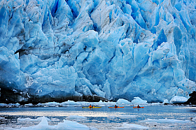 Kayaking at the base of a glacier in Pia fjord, adventure at Tierra del Fuego Patagonia Chile