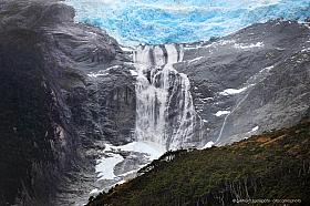 Massive waterfall of meltwater emerging from Romanche glacier, Isla Grande de Tierra del Fuego, Parque Nacional Alberto de Agostini