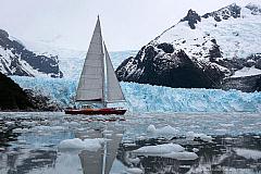 Yacht Icebird sailing along the glacier front of Pia fjord, Tierra del Fuego Patagonia