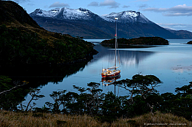 Sailing yacht Icebird anchoring in a bay of the Beagle Channel, Tierra del Fuego Chile