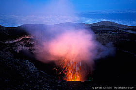 Villarrica volcano eruption at twilight seen from the crater edge